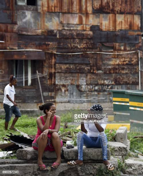 Local residents chat at El Chorrillo neighborhood which was the stronghold of President Manuel Noriega on May 30 2017 in Panama City Panama's former...