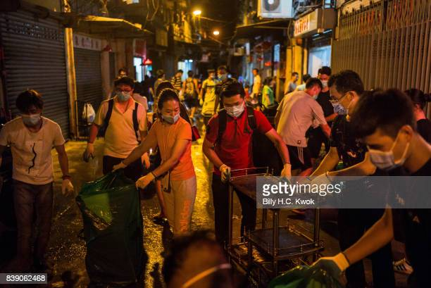 Local residents clean debris after Typhoon Hato hits Macau on August 23 2017 in Macau China The death toll in Macau from Typhoon Hato rose to nine on...