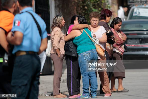 Local residents gather on January 2 2016 outside the house of Gisela Mota newly elected Mayor of Temixco Morelos State Mexico murdered on Saturday at...