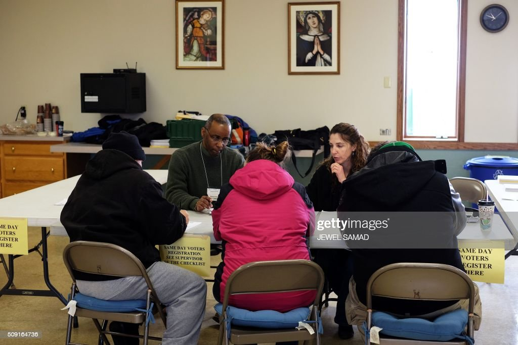 Local residents get registered to vote for the first US presidential primary at a church in Concord, New Hampshire, on February 9, 2016. New Hampshire voters headed to polls at the snowy break of day on February 9 for the crucial first US presidential primary, with Donald Trump chasing victory and Hillary Clinton looking to narrow the gap on Bernie Sanders. The northeastern state, home to just 1.3 million people, sets the tone for the primaries -- and could shake out a crowded Republican field as the arch-conservative Senator Ted Cruz and establishment candidates led by Marco Rubio battle for second place behind the frontrunner Trump. / AFP / Jewel Samad