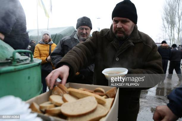 Local residents get some food distributed in Avdiivka Donetsk region on February 5 2017 Fighting subsided around a flashpoint Ukrainian town on...