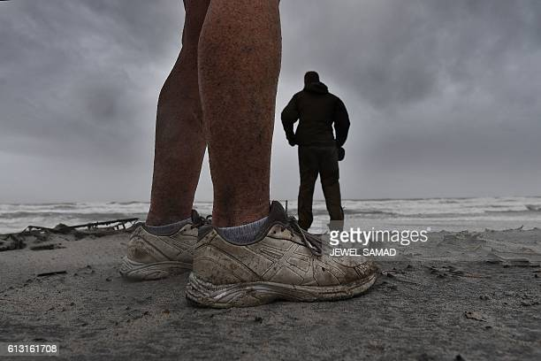 Local residents Graig Fairbairn and Riga Fairbarn who opt out to leave their home on the costal line watch the wave at the Atlantic Beach Florida on...