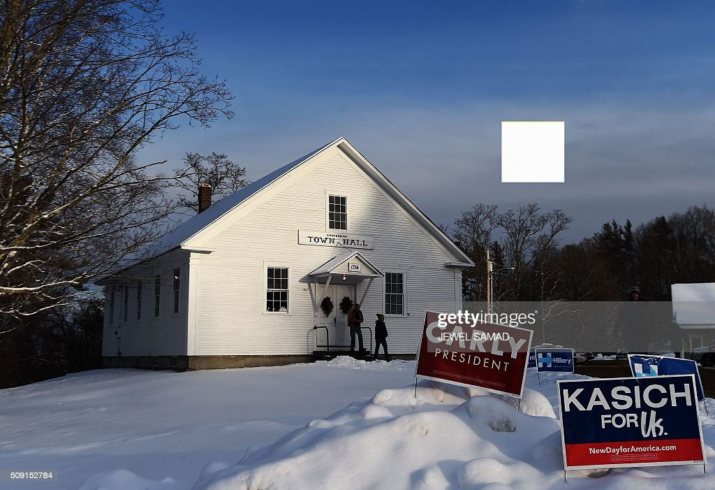 Local residents leave the town hall after voting for the first US presidential primary in Canterbury, New Hampshire, on February 9, 2016. New Hampshire began voting on February 9 in the first US presidential primary with Republican Donald Trump calling on supporters to propel him to victory and Democrat Bernie Sanders primed to upstage Hillary Clinton. The northeastern state, home to just 1.3 million people, sets the tone for the primaries and could shake out a crowded Republican field of candidates pitting Trump and arch-conservative Senator Ted Cruz against more establishment candidates led by Senator Marco Rubio. / AFP / Jewel Samad
