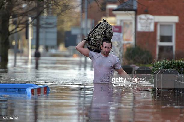 Local residents leave their homes as Storm Desmond causes flooding on December 6 2015 in Carlisle England Storm Desmond has brought severe disruption...