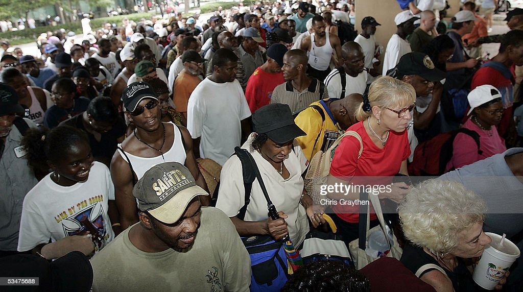 Local residents line up for admission to the New Orleans Superdome as it opens as an emergency shelter ahead of Hurricane Katrina August 28, 2005 in New Orleans, Louisiana. The storm is expected to make landfall in the morning of August 29.