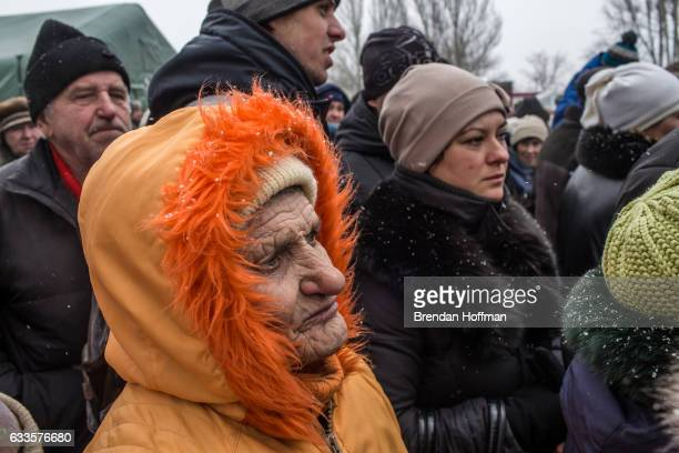 Local residents line up to receive free bread at a humanitarian aid distribution point on February 2 2017 in Avdiivka Ukraine The conflict in the...