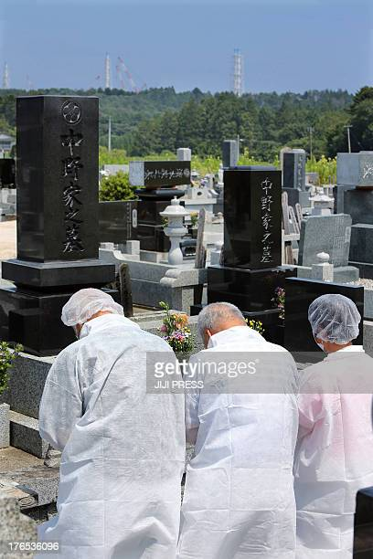 Local residents of the town of Okuma near the stricken nuclear plant in Fukushima prefecture and now relocated to Aizuwakamatsu after being evacuated...