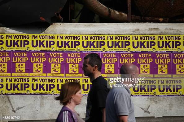 Local residents pass UK Independence Party general election campaign flyers at the docks in Boston Lincolnshire on April 8 2015 Farage is campaigning...