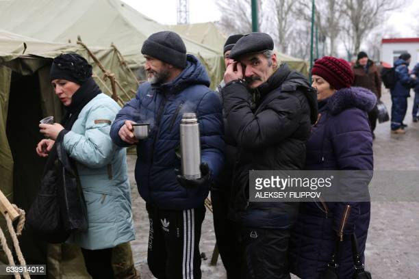 Local residents queue to get some food distributed in Avdiivka Donetsk region on February 5 2017 Fighting subsided around a flashpoint Ukrainian town...