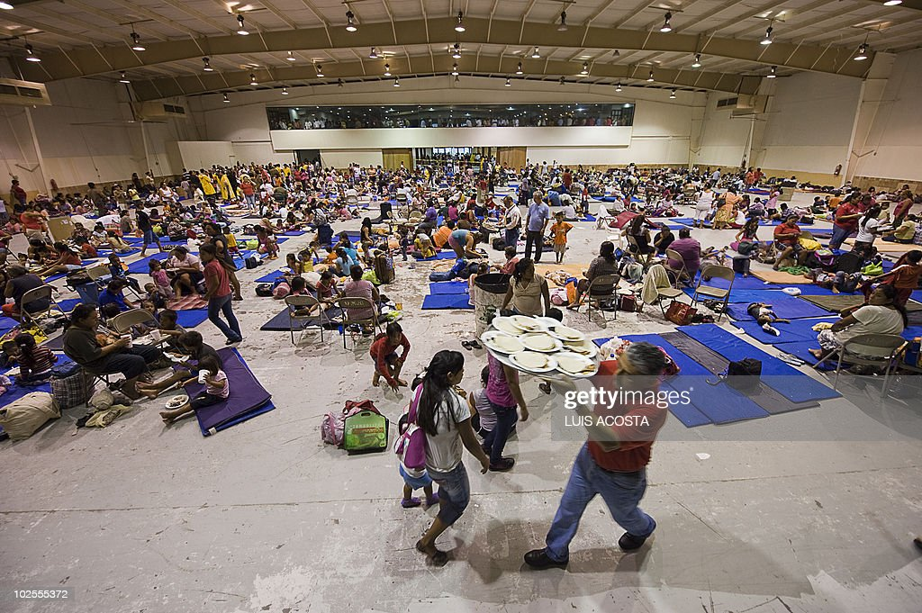 local residents rest at a shelter before the arrival of Hurricane Alex, in Matamoros, Tamaulipas state, Mexico on June 30, 2010. Alex was set to make landfall late Wednesday or early Thursday south of the US border with Mexico, possibly as a Category Two hurricane, the Miami-based National Hurricane Center said. AFP PHOTO/Luis Acosta