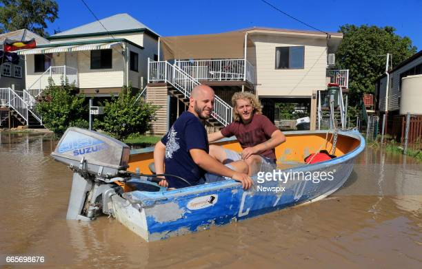 ROCKHAMPTON QLD Local residents Ryan and Adam Swadling prepare to take their boat through floodwaters in Rockhampton Queensland after the Fitzroy...