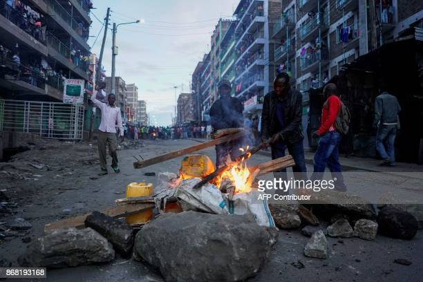 TOPSHOT Local residents set up a roadblock after the announcement of the reelection's result by Kenya's Independent Electoral and Boundaries...