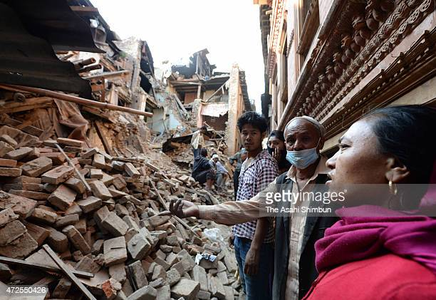 Local residents stand at debris on May 3 2015 in Bhaktapur Nepal A major 79 earthquake hit Kathmandu midday on Saturday 25th April and was followed...