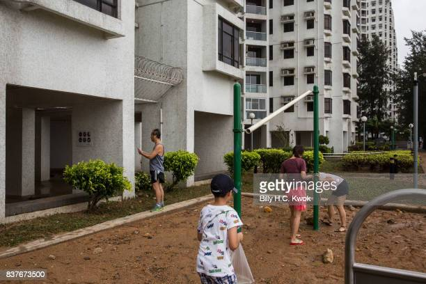 Local residents stand at the damaged area as Typhoon Hato hits Hong Kong on August 23 2017 in Hong Kong Hong Kong Hong Kong's weather authorities...