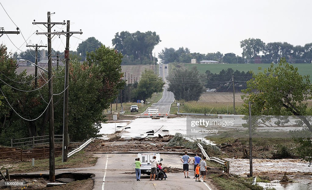 Local residents take in a close up view of a damaged bridge on Weld County Road 1 on September 13, 2013 in Longmont, Colorado. Heavy rains for the better part of week have fueled widespread flooding in numerous Colorado towns.
