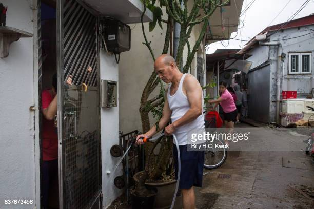 Local residents tidy their house as Typhoon Hato hits Hong Kong on August 23 2017 in Hong Kong Hong Kong Hong Kong's weather authorities raised...