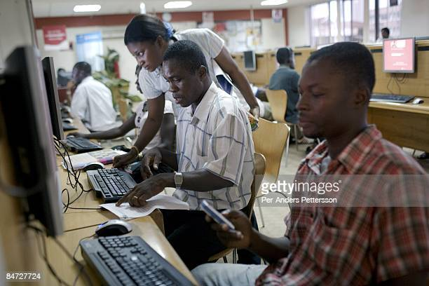 Local residents use computers at Busy Internet Cafe on June 12 2008 in central Accra Ghana
