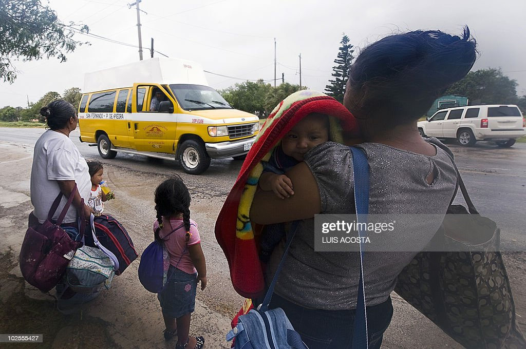 Local residents wait for tranportation in Matamoros, Tamaulipas state, Mexico before the arrival of Hurricane Alex, on June 30, 2010. Alex was set to make landfall late June 30 or early July 1 south of the US border with Mexico, possibly as a category two hurricane, the Miami-based National Hurricane Center said. AFP PHOTO/Luis Acosta