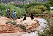 Local residents walk along the edge of Short Creek where two vans were swept away the day before on September 15 2015 in Colorado City Arizona Flash...