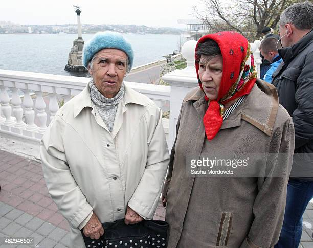 Local residents walk in the streets on April 5 2014 in Sevastopol in the disputed Crimean Peninsula Many Ukrainian banks are already closed in Crimea...