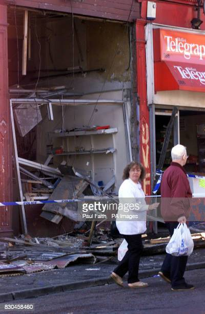 Local residents walk past the UDA prisoners office on the Shankill road in Belfast which was wrecked in a bomb blast early morning Monday September...