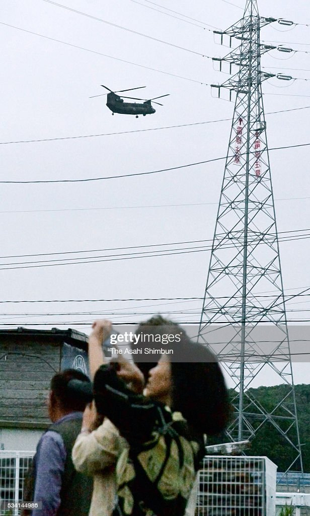 Local residents watch a helicopter which world leaders are shuttled from Centrair International Airport on May 25, 2016 in Shima, Mie, Japan. The Group of Seven summit takes place on May 26 and 27 to discuss key global issues such as global economy and anti terrorism measures.