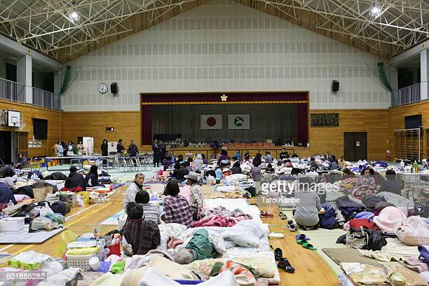 Local residents who had to evacuate their houses after the earthquake gather at Kawahara elementary school on April 17 2016 in Nishihara Kumamoto...