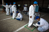 Local residents who live around the 20km exclusion zone around the Fukushima DaiIchi Nuclear Power Plant undergo a screening test for possible...