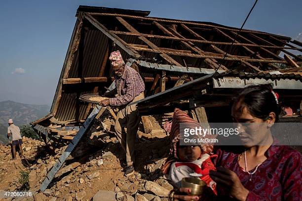 Local residents work to rebuild their home in Bhotechaur Nepal on May 3 2015 in Kathmandu Nepal A major 79 earthquake hit Kathmandu midday on...
