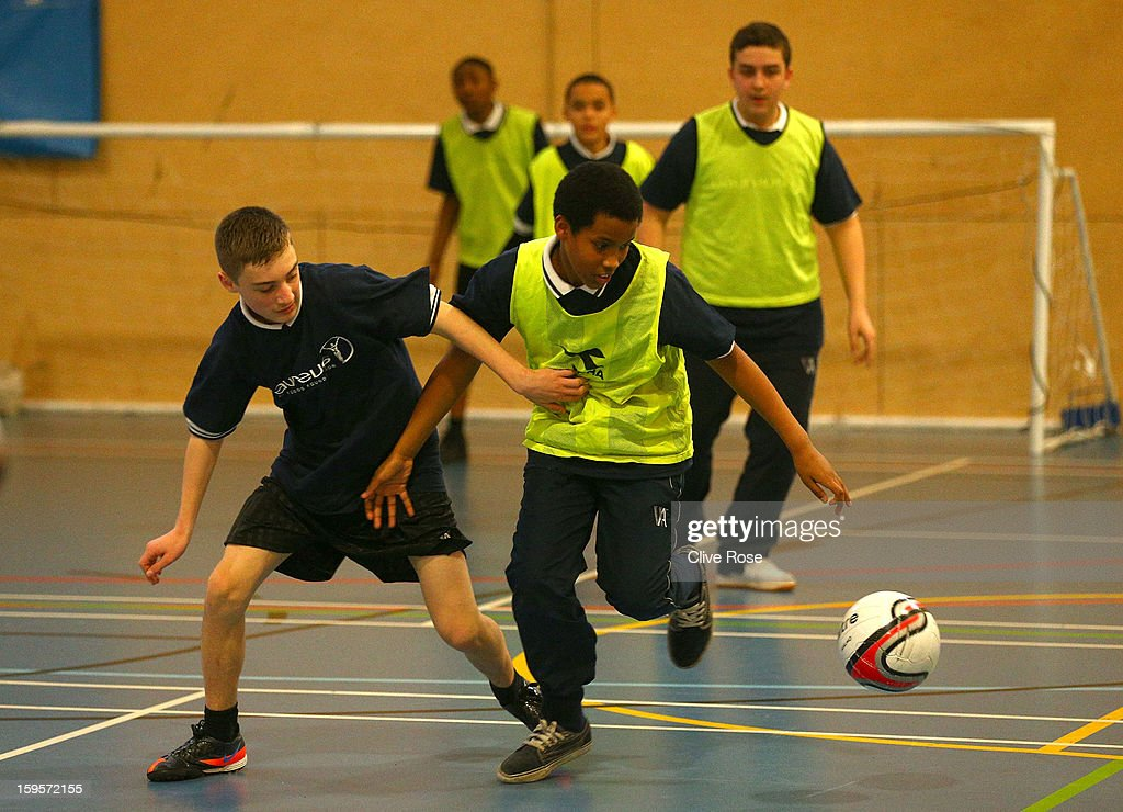 Local school children participate in a football match under the coaching of Andre Villa Boas during the Laureus Urban Research report launch on January 16, 2013 in London, England.