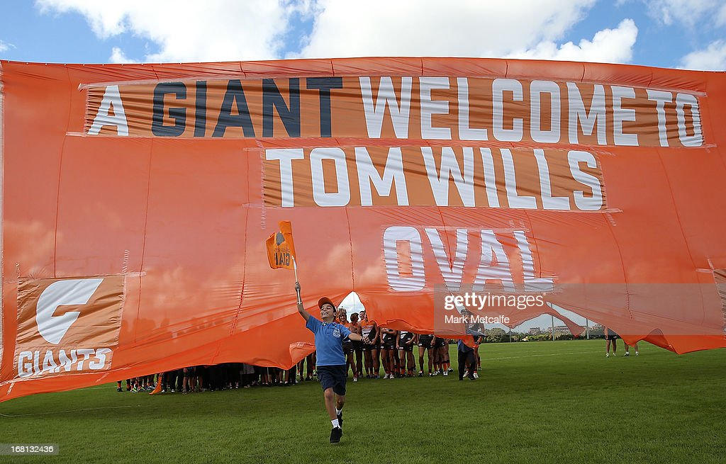 Local school children run through a banner during a GWS Giants AFL media session at Sydney Olympic Park Sports Centre on May 6, 2013 in Sydney, Australia.