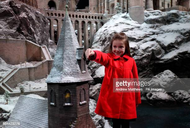 Local school girl Robyn aged 7 adds some of the last sprinkles of snow to the model of Hogwarts School at Warner Bros Studio Tour London The Making...