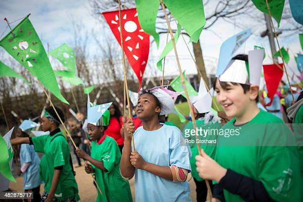 Local schoolchildren take part in an opening parade at the Olympic Park on April 5 2014 in London England The Queen Elizabeth Olympic Park in east...