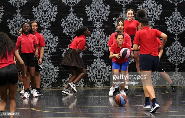 Local schoolgirls play basketball during the launch of the Fight 4 Change female only 'Contenders' initiative on March 11 2016 in London England