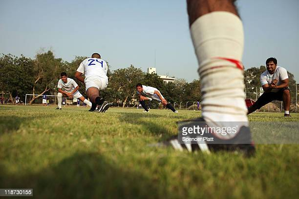 A local soccer team stretches on the pitch before a match on July 10 2011 in Baghdad Iraq As the deadline for the departure of the remaining American...