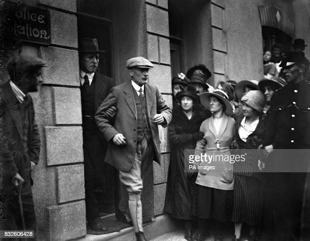 Local solicitor Mr Harold Greenwood leaving Kidwelly police Station for Llanelly where he will be charged with the murder of his wife Mabel by...