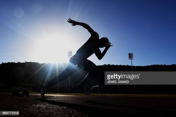 A local sprinter trains in an outfield track at the national stadium in Kingston Jamaica on June 8 2017 Usain Bolt's imminent retirement is a blow...