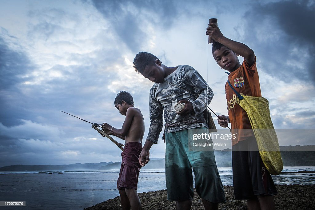 Local Sumbanese villagers prepare their fishing equipment on the reef at Nihiwatu Beach, Western Sumba on April 11, 2013. Sumba is a remote island in Eastern Indonesia, part of the Lesser Sunda Islands group based in the province of East Nusa Teng.