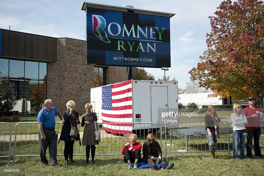 Local supporters wait in a crowd at Shawnee State University to hear Republican presidential candidate, former Massachusetts Gov. Mitt Romney speak on October 13, 2012 in Portsmouth, Ohio. The Romney and Obama campaigns have been concentrating their efforts on Ohio to gain more supporters as Election Day approaches.