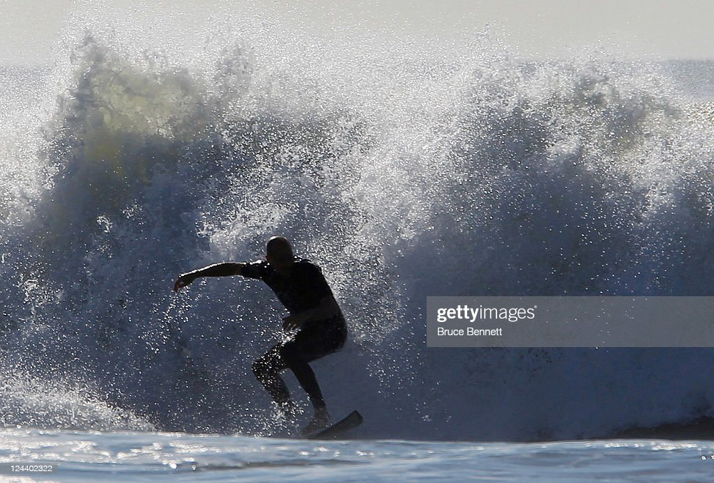 Local surfers hit the waves on the beach adjacent to the Quiksilver Pro New York tournament on September 9 2011 in Long Beach New York