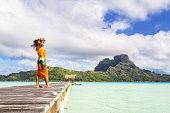 Local tahitian woman on jetty, Bora Bora lagoon