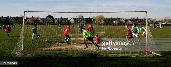 Local teams play Sunday league football on the Prince George's Playing Fields on February 10 2008 in Raynes Park London England
