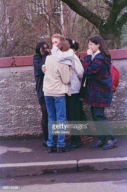 Local teenagers support each other after the massacre at Dunblane Primary School in Scotland in which 17 people were killed 17th March 1996