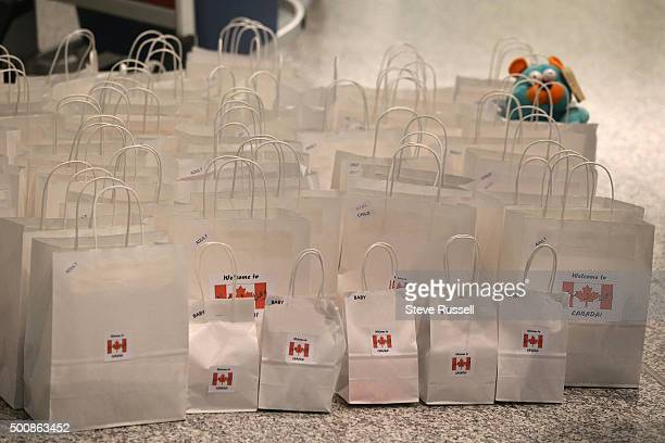 A local Toronto group put together gift bags for arriving refugees the bags had items added as people arrive to greet the refugees Syrian refugees...