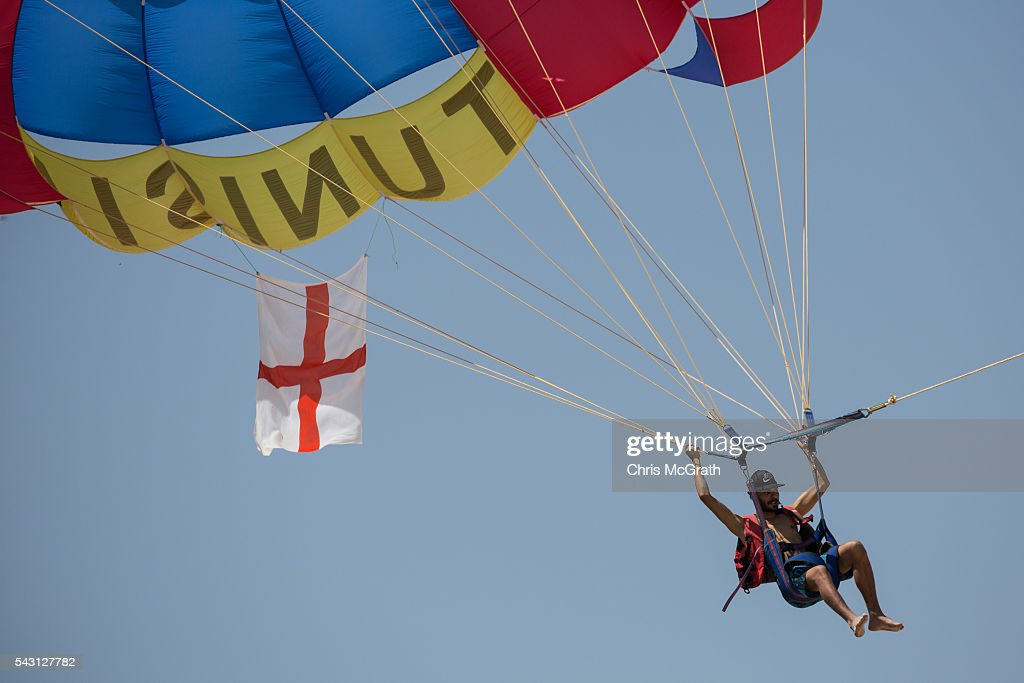 A local tour operator parasails with an England flag over the beach in front of the Imperial Marhaba hotel on June 26, 2016 in Sousse, Tunisia. Today marks the one year anniversary of the Sousse Beach terrorist attack, which killed 38 people including 30 Britons. Before the 2011 revolution, tourism in Tunisia accounted for approximately 7% of the country's GDP. The two 2015 terrorist attacks at the Bardo Museum and Sousse Beach saw tourism numbers plummet even further forcing hotels to close and many tourism and hospitality workers to lose their jobs.