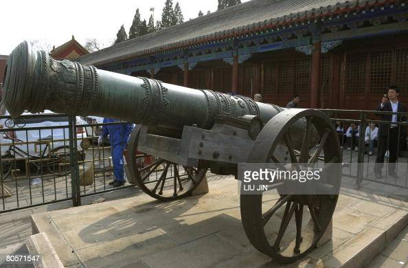 A local tourist takes pictures of a threehundred year old ancient cannon in Beijing on April 09 2008 The six parties to the North Korean nuclear...