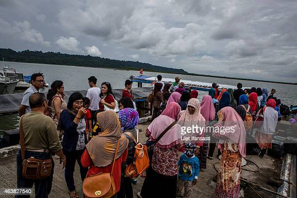 Local tourists waiting for their boat at tourist port as they trip around Nusa Kambangan island where the Bali Nine are due at some point to be...