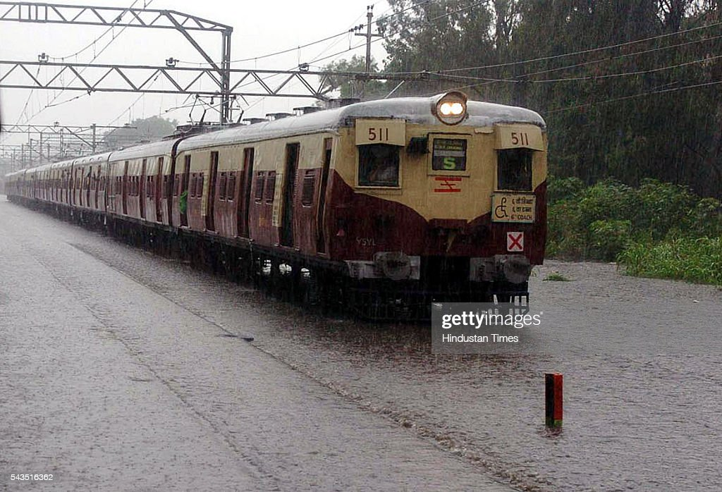 Local trains stranded as railway tracks vanishes under the flooded water caused by heavy rain in the Mumbai city on July 22, 2005 in Mumbai, India.