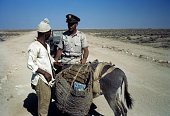 A local tribesmen with a donkey is stopped by a member of the 376th Bombardment Group at the US Air Force Base in Benghazi Libya