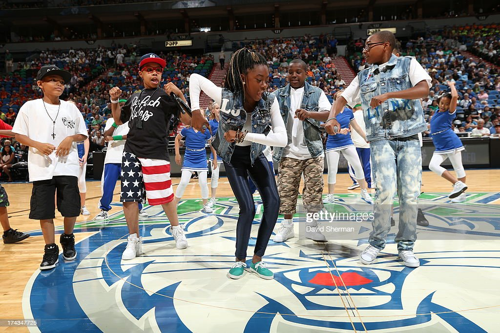 Local Twin Cities YMCA kids perform their hit single 'Hot Cheetos and Takis' during the Minnesota Lynx WNBA game against the Phoenix Mercury on July 24, 2013 at Target Center in Minneapolis, Minnesota.